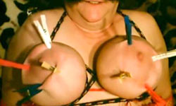Clothespins on huge tits